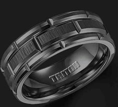 Its tungsten, and i totally want a small sapphire in the center of each of the rectangles that make up the center ring.