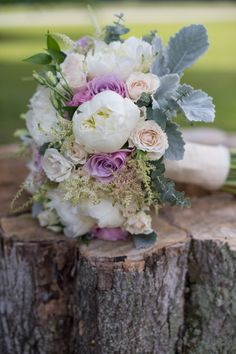 purple and white rose wedding bouquet