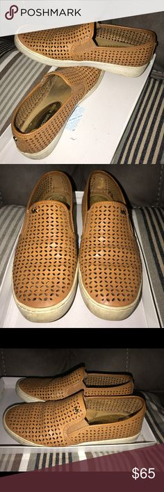 """MK Olivia Perforated Slip-On Sneaker Peanut Brown USED. Authentic. Bought at Saks Fifth. MICHAEL Michael Kors sneaker in perforated leather. 1.5"""" flat heel. Round toe. Gored stretch insets. Golden logo button details. Embossed logo at heel. Slip-on style. Rubber sole Michael Kors Shoes Flats & Loafers"""