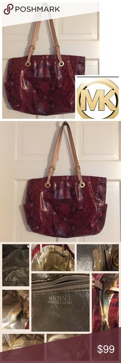 """🍾MICHAEL Michael Kors Red Python Tote Michael Kors red python tore. Excellent condition outside with minor wear on shoulder strap. Inside the metallic is coming off in a few places but no one will know when you are carrying it.   18"""" x 13"""" x 4"""" with interior pockets. A fabulous bag at a bargain! MICHAEL Michael Kors Bags Totes"""
