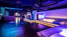7 Heaven night club in Lan Kwai Fong, Hong Kong designed by Liquid Interiors. night club design, dance floor design, colorful lighting, cove lighting, LED screen, wall tiles design, black and white, booth design, simple and modern