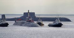 """Project 941 """"Akula"""" (shark) class SSBN (NATO designation: Typhoon) in the background and her replacement- Project 955 """"Borei"""" (Northwind) SSBN in the foreground."""