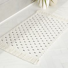 Shop Desma Stitch Black and White Bathmat. Finished on two sides with fringe, this simple diamond-stitch bath mat adds interest to any bathroom floor. Warm white and black––a modern neutral palette that can't go wrong. Bathroom Rugs, Bath Rugs, Bathroom Flooring, Modern Bathroom, Bathroom Ideas, Master Bathroom, Modern Bath Mats, Vinyl Flooring, White Bathroom Decor