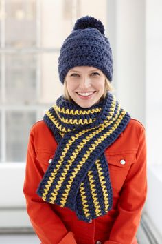 Create this stylish pompom hat and striped scarf in the colors of your school or sports team.