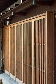 Japanese sliding doors in Kamamura, Japan. Space between the timber slats allow a glimpse of the the view on the otherside of the door.