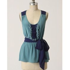 """Anthropologie Silk Blouse Gorgeous """"gentle waves"""" blue sleeveless blouse, with ruffle detail and sash waist. Perfect under Blazers or cardigans, and stunning alone! 100% silk. Gently cared for. Tag is loose and one minor snag on sash (shown in pic). Anthropologie Tops Blouses"""