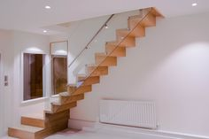 Both the client and we put much heart and soul into this very project. We were asked to create a stylish staircase that would make the family feel at home. Stair Railing Design, Contemporary Stairs, Wooden Stairs, Exterior Remodel, Zig Zag, Townhouse, Staircases, New Homes, Houses
