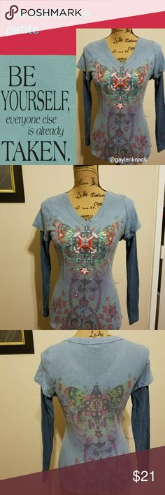 "Live & Let Live Henley ✨ Pretty slate blue Henley with darker blue false sleeves, and a fantastic butterfly design on the front lit up by teal, pale pink, & rust embroidery.  Add sparkling silver studwork and it's definitely a standout piece! Leaves cascade over the shoulders, and the pattern is repeated on the back.  Measurements are 17.5"", 16.5"", 19"". live and let live Tops Tees - Long Sleeve"