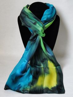 Hand painted silk scarf in stunning shades of yellow, turquoise blue lime green tones. Fashion silk scarves can be worn as a head, hair or neck wrap. Each handmade scarf is individually painted and truly one-of-a-kind. Oblong silk scarf is appr...