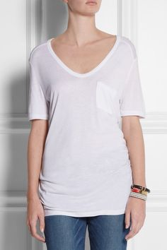 White semi-sheer jersey Front patch pocket Slips on 100% rayon Hand wash