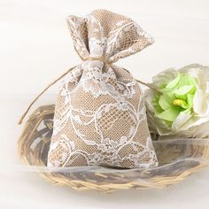 Elegant favor or bridal shower bags made from delicate lace and burlap, the sachets come complete with twine fastening and are perfect for storing little goodies.