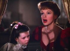 20 of pop culture's most show-stopping red dresses Judy Garland Movies, Judy Garland Liza Minnelli, Popular Christmas Songs, Robert Walker, Gloria Dehaven, Minnie Driver, Olivia Hussey, Gentlemen Prefer Blondes, Film Images