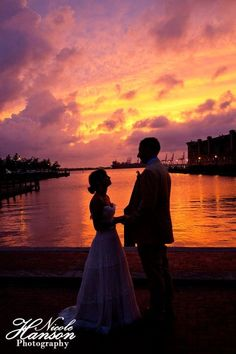 I love the #pink sunset tones in this #wedding photo. What an amazing way to conclude your special day.