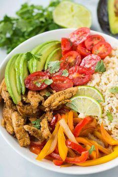 Delicious Vegan Fajita Rice Bowl is the perfect meal in a bowl, its colorful full of balanced amount of veggies, starch and protein.