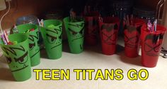 My son thinks he is too old for treat bags so I made these for his Teen Titan party. I bought the cups at Dollar tree and drew Beast Boy and Robin on them to match his cake. Filled with candy, etc.