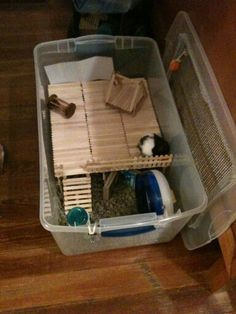 Budget Hamster cage, popsicle sticks, large plastic storage bin, wire mesh for the lid, glue gun, use a heated box cutter to cut of the middle section of the lid, my storage bin had locks on the handles.