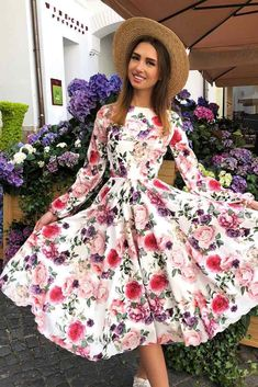 Tea Length Floral Dress With Long Sleeves #longdress #whitedress #longsleeves★ Need some floral dresses ideas for inspiration? This summer, sport long, short, midi, and maxi dresses with floral patterns. ★ See more: http://glaminati.com/charming-floral-dresses-designs/ #floraldresses #floraldressesdesigns #summerdress #glaminati #lifestyle