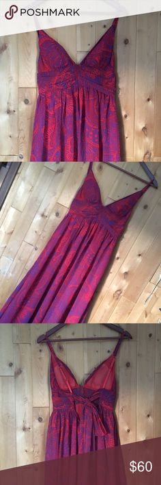 Boho Maxi Dress Flowing Maxi dress has exquisite pattern and will be perfect for upcoming music festivals. The color is a purple/navy with coral. The cups are lined and feature adjustable straps. The back has an elastic border and two long flowing ties to cinch the waist. Moda International Dresses Maxi
