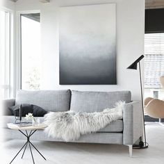 #hint sticking with greyscale is a fine color scheme. Find the painting first, then match your sofa, coffee table, lamp and accessories to the painting. #colorscheme #designer #askadesigner #design #interiordesign