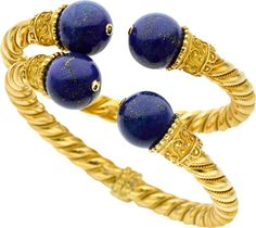 two matching bracelets, both set in 18k yellow gold with a hinged mechanism and set with lapis.  These pieces are heavy, gorgeous gold bracelets that are future heirloom-worthy