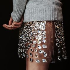 Michael Kors / @michaelkors - Michael Kors gets up close and personal with his bejeweled PVC skirt.