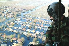 OVER NEW ORLEANS -- Tech. Keith Berry looks down into flooded streets searching for survivors. He is part of an Air Force Reserve team credited with saving more than people in the aftermath of Hurricane Katrina. He is a pararescueman with. Climate Change Report, The National, National Guard, Guatemala City, Severe Weather, Natural Disasters, Global Warming, Maui, Europe