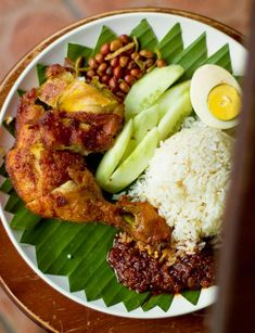 """Nasi Lemak - a fragrant rice dish cooked in coconut milk and """"pandan"""" leaf commonly found in Malaysia."""