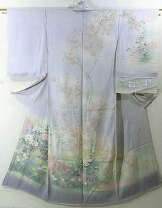 This is a kimono fabric cut into Houmongi Kimono shape and stitched roughly before sewing to make it.  It has been dyed beautiful ume(Japanese apricot) design