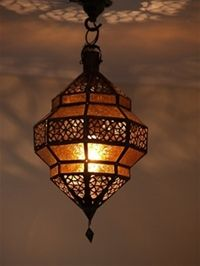 moroccan lantern with amber coloured panels.