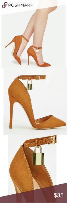Whiskey Pumps Want to make a few jaws drop? Of course you do!!! Then go ahead and grab this beautiful faux suede pump, which features a wrap-around buckle and lock accent.  Approx. Heel Height 4.5 Synthetic Upper Man Made Sole Shoe Box Included Shoes Heels