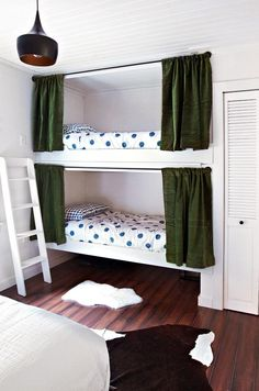 Great bunk room idea; provides a little privacy and allows others to sleep in :)