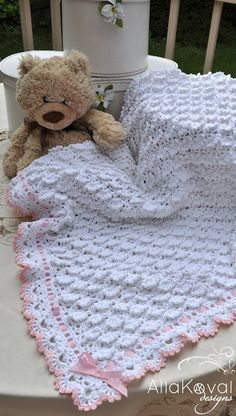 The skys the limit! Give Baby the sweetest of sleep and the best of dreams with this unbelievably luxurious afghan. Fluffy crochet shells come together to create billows of heavenly softness, just right for Babys delicate skin. Its a perfect gift for boys and girls alike—just trim it
