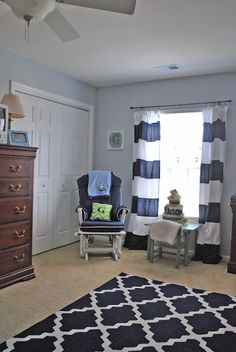 Gray walls, white curtains with navy stripes sewed on, blue rug on Overstock