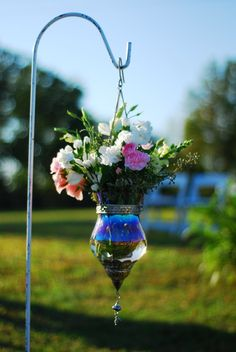 Asile decor on iron sheppards hook with snap dragons, carnations, lisianthus and assorted greenery