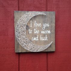 These I love you to the moon and back signs are hand painted and hand strung with string on weathered wooden boards. The dimensions are approximately 11 by 11 inches. Due to the nature of the wood, each piece is unique and may vary from what you see in the picture but we feel that this makes each order a real one of a kind. These come with sawtooth hanger so they are ready to hang. If you would like to order a larger board please contact me and we can set something up. Items usually take 1-2…