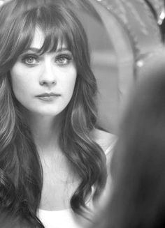 I do believe this is Zooey Deschanel, one of the greatest actresses ever. If not, it's still a beautiful picture.