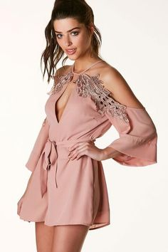 9bb7ede819 Flowy chiffon romper with halter style neckline and cold shoulder cut outs.  Cropped sleeves with