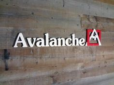 """Custom precision cut-out dimensional individual 1/4"""" thick brushed satin aluminum metal letters and logo pin mounted onto interior wall with spacers in NYC. For more information on business signs and lettering, visit http://www.VisualSigns.com"""