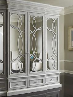 Beautiful circular design fretwork to wardrobes, with mirror behind