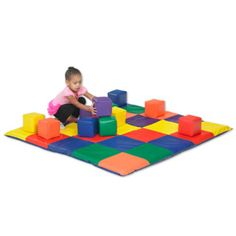 """Patchwork mat and blocks are made of a colorful, soft vinyl with super-soft, furniture-grade foam core that keeps playtime safe and stimulating for even the youngest children. At 5-1/2"""" wide, toddler blocks are just the right size for tiny hands! Teach manual manipulation and color recognition by encouraging children to match the blocks to the colors in the mat. Non-toxic, phthalate free. (Group E Ship)"""