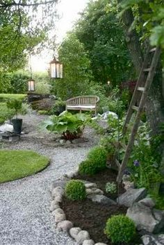 Love the gravel paths leading to the pond of my home and the secret sitting places to read and relax. Veranda magazine, French style patio