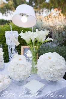Vintage wedding in Athens - White laces and fabrics, orchids Phalaenopsis,, tulips, calas, hydrangeas and anemones were decorating the reception venue and church. Apart from the wedding cake which was a real masterpiece decorated with handmade sculpted anemones from sugar - creation of Elite Events Athens , the wish table was so special & outstanding that the guests took didn't leave not even one koufeto or wedding buiscuits that were on the table!