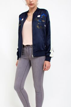 This navy bomber jacket comes artfully adorned with embroidered flowers on the front and back. Ecru stripes on the sleeves bring a sporty feel to this piece that will breathe new life into your outerwear edit. Wear yours with angular-cut skirts for a sharp aesthetic with urban appeal. By Mbym.