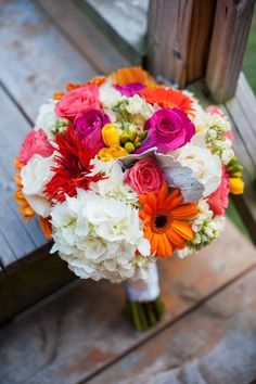 Bright and lovely bouquet of roses, hydrangeas, daisies, and spider mums! {Lexi Photography}