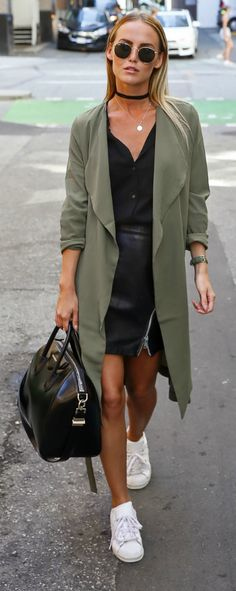 Olive green + military chic + streetwear + polished off + matching watch + crisp white sneakers + simple black choker + delicate silver chain + open neck of this soft black blouse + Kristin Sundberg.