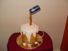 mike's beer mug birthday cake - white cake (two tiers of 8 in rounds)iced in buttercream,whip -n-ice for the foam,poured sugar on a dowel with a beer can on top.gumpaste handle,and fondant pretzels & peanuts.2nd pic has a gumpaste figure that was added.this is the 2nd beer mug cake i've done for a friend.tfl