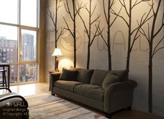 I've already experienced the joy of painting a tree mural (and then painting back over) but I still enjoy this idea of trees indoors. It's very easy to paint a tree, but for another solution use vinyl decals like these from NouWall on etsy.