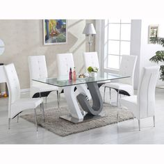 Barcelona Dining Table In Clear Glass Top With Stainless Steel Base with 6 Vesta Chairs in faux leather Select the Chairs colour from above option Finish: Clear Glass, Grey And White Gloss And Stai.