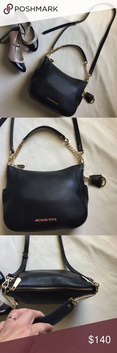 MK Chandler Purse Genuine Michael Kors,soft leather purse,gold hardware & leather short strap,& leather longer one.wore as hobo or cross body,draped side chain w/Mk logo.Black interior.Interior capacity is small.Will carry small wallet,sunglasses,phone & keys.key chain in interior.dimensions at widest is 10.5 inches & height is 8.5 inches.no signs of wear.wore 2 to 3 times & too small for me.trades. Michael Kors Bags Hobos