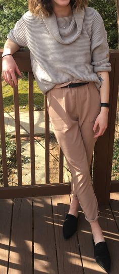 Winter/spring transition outfit. Black mules. Khaki trousers. Grey sweater.
